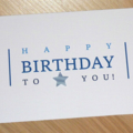 Male Happy Birthday card - blue text with star