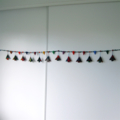 Decorative felted pine tree and heart garland