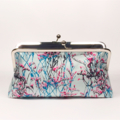 Dried flowers in blue large clutch purse