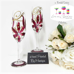Personalised Ruby Champagne Glasses by inaspinniquesway