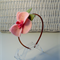 Head band with Pink Phalaenopsis Orchid.