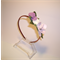 Head band with lilac frangipane flower and rose