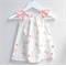 Peaches & Cream Rosemilk Dress with peach flutter sleeves. Size 00 to 3