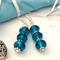 crystal cut turquoise glass earrings . gift wrapped .