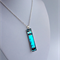 Turquoise and black glass and millefiori pendant
