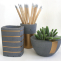 set of three charcoal concrete planter pots. square, tall, bowl, gold designs