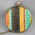 Large round resin women's pendant necklace, vintage measuring tape ruler print