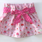 Paper bag style skirt with sash
