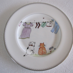 Hand painted Wedgwood plate with cat and dog watching washing on the line