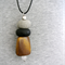 DROPS Black + Stone Polymer Clay with Wood and Quartz on Black Leather