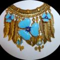 Blue enamel bib, charm necklace