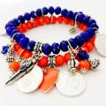 Stacked charm bracelets. Cobalt blue and orange crystal cut glass beaded set