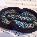 Crocheted hair clip made from pure wool. Black, white and blue