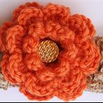 Beige Headband with orange Flower detail