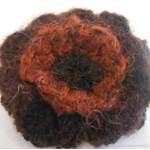 Crocheted hair clip made from mohair blend yarn. Burgundy and brown