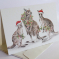 Christmas Card with Kangaroo family, gum blossom and leaf wreath, Santa hats