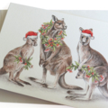 Christmas Card with Kangaroo family, gum blossom and leaf wreath, Santa hats