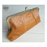 Tan Ostrich printed leather clasp clutch