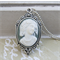 Free shipping.  Sage and White coloured cameo pendant.
