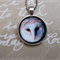 Free shipping. Barn Owl Pendant. Silver Plated with free fine ball chain.