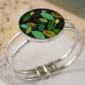 Women's round resin silver cuff bracelet bangle, leaves, green, black, print