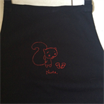 """Embroidered black """"Nuts"""" apron"""