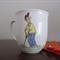 Hand painted mug with golfers