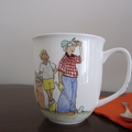 Hand painted mug with golfers