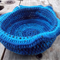 Crocheted bowl made from cotton and pure wool yarns. Blues and black