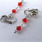 Red and white clip-on silver earrings