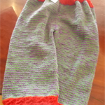 Hand knitted striped pants for child, purple green and red.