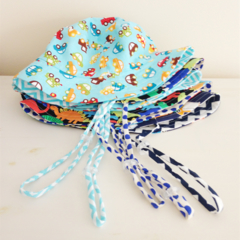 Boys summer hat with strap & toggle