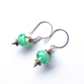 Swirled green glass and sterling silver earrings