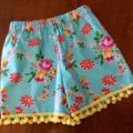 Pretty Girls shorts , size 2 Pom Pom trim, free headband .