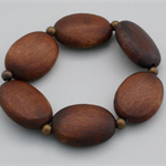 Oval dark wood bead and brass bead stretch bracelet