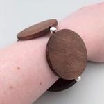 Bold round dark wooden bead and silver bead stretch bracelet