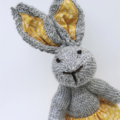 Felicity the Knitted Bunny Rabbit Toy with Yellow Party Skirt with Pompom trim