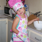 Pink apron, chef's hat and oven mitt.