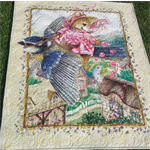 Kid's bright quilt featuring Bunny flying on a bird