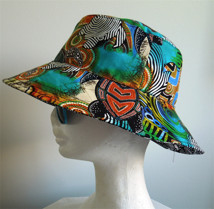 Kids Reversible Bucket Hat. Small size 50cm. Dot Painting Turtles and  Goannas. 68f04c5828e