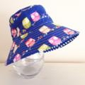 Girls summer hat in blue owl pattern