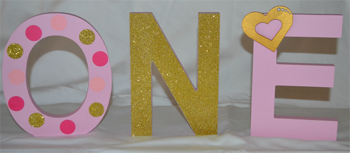 girls first birthday decorative wooden letters pink and gold theme