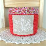 crochet storage basket, red  with agapanthus and flowers,