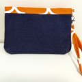 Denim and orange and white wristlet with bobble print lining