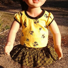 Black and yellow geometric skirt with matching appliqued tshirt and sneakers