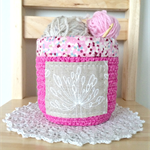 crochet storage basket, pink with agapanthus and polka dots
