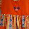 Girl's seersucker dress with orange bodice, back buttoning opening 3 - 5 yrs