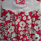 Girls sleeveless dress with floral skirt and white bodice, size 2 - 3 yrs