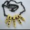Yellow porcelain fingers, black design, matt finish