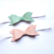 Leatherette pale Pink and Mint Green Bow pair of Headbands.